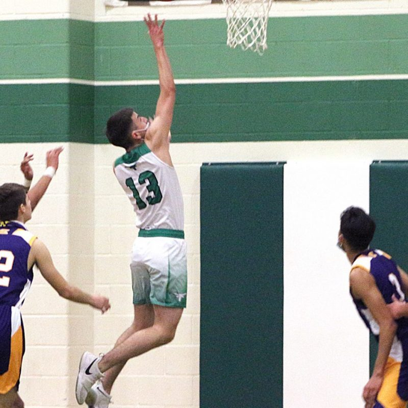 Isaiah Garcia splits the defense and goes in for an easy layup during recent district action. Pearsall will open the playoffs Tuesday. (CURRENT Photo: Manuel Azocar III)