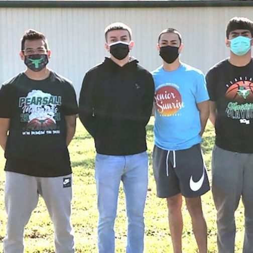 Members of the Pearsall High School varsity basketball team joined volunteers efforts by the San Antonio Food Bank in distributing food bags to local residents affected by the power outages and water shortages resulting from the record cold weather last week. Joining PHS Head Coach John Hernandez were Nicholas Martinez, Isaiah Garcia, RJ Ortiz, Joey Ramirez and Marco Camacho.